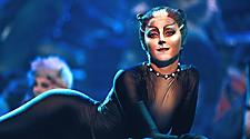 A woman dressed like a black cat with cat makeup during a Cats broadway show on Oasis.