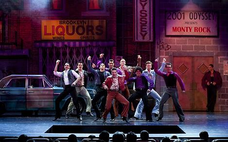 Men dancing on main stage during Saturday Night Fever Broadway show on Liberty.