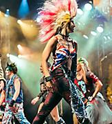 Rockers with mohawks singing to We Will Rock You soundtrack in broadway show onboard a cruise ship.