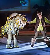 Two performers dressed as a dragon and trainer during the How to Train Your dragon ice skating show.