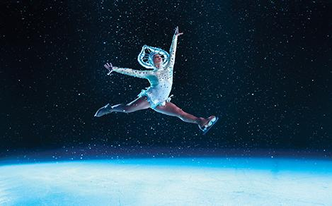Women performer jumping during ice skating shows onboard a cruise.