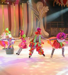 Clumsy Clowns skating on a brightly colored rink in ice skating show Ice Under the Big Top.