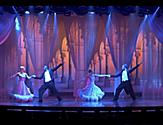 Performers dancing on stage during the Ballroom Fever Cruise Show on Navigator of the Seas