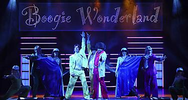The performance crew of the Boogie Wonderland Cruise Show on stage in Majesty of the Seas