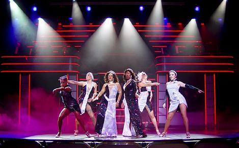 Women performing on stage for the Boogie Wonderland Cruise Show, Vision of the Seas