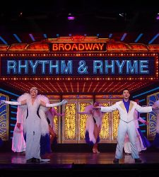Performers dancing on stage for the Rhythm and Rhyme Cruise Show on Grandeur of the Seas