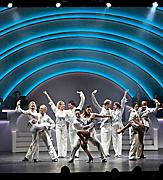 Performers dressed in white on stage during the Center Stage Cruise Show on Brilliance of the Seas
