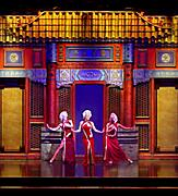 Performers in red dresses on stage during City of Dreams Cruise Show on Jewel of the Seas