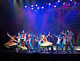 Performers on stage dressed as hamburgers and sharks dancing during the Columbus Musical Cruise Show by Royal Caribbean