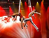 Acrobatic couple performing on stage during the Live Love Legs Cruise Show by Royal Caribbean