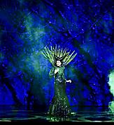 Performer dress in green on fantasy like stage during the Freedom of the Once Upon a Time Cruise Show