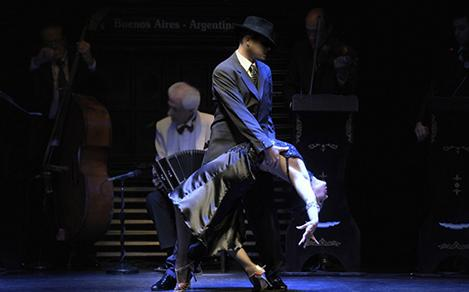 Tango couple dancing on stage during the Tango Buenos Aires Cruise Show by Royal Caribbean