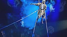 Performer doing a stunt on stage during The Gift Cruise Show by Royal Caribbean