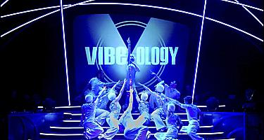 Performers on blue stage during the Vibeology Cruise Show on Serenade of the Seas