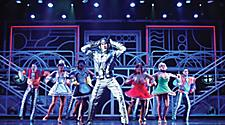 Performers dresses in costumes on stage during the West End to Broadway Cruise Show on Jewel of the Seas
