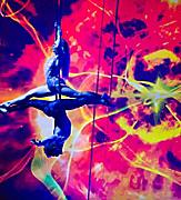 Two performers suspended doing aerial acrobat tricks during the Starwater show on Quantum.