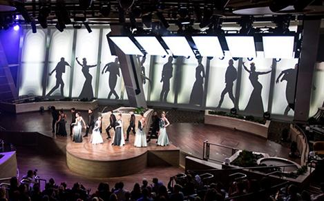Performers on stage with their sillouettes behind them during the Starwater show on Quantum.