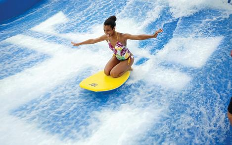 Young Woman Body Surfing Flowrider