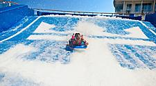 HM, Harmony of the Seas,  Flowrider, young woman on Flow Rider, fun, excitement, surf, onboard surfing,