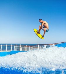 Man Doing Air Trick on Flowrider