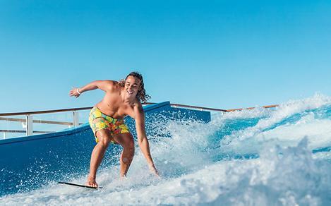 Man Surfing and Splashing on the Flowrider