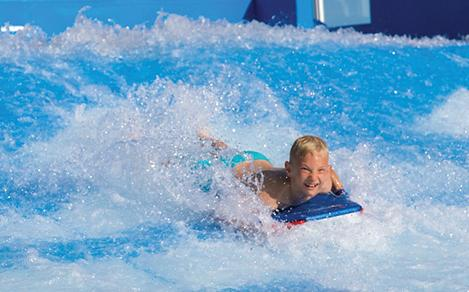 Boy Body Surfing on Flowrider Laughing
