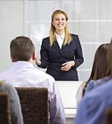Woman Conducting a Business Seminar