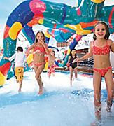 Children Playing and Splashing in the H20 Zone Water Park