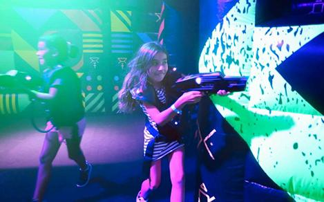A girl playing laser tag onboard a cruise ship