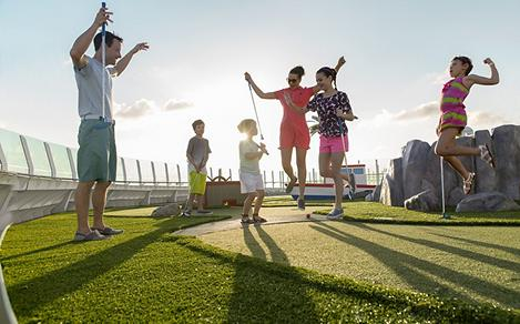 Family Playing Mini Golf on Liberty of the Seas