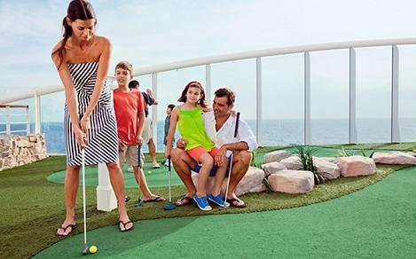 Family Playing Mini Golf Onboard