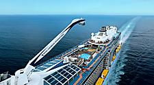 AN, Anthem of the Seas, Come Seek shoot Dec 2015 in Bahamas, aerials, at sea, ship exterior, overhead close 3/4 view port side and top deck, angled toward rear of ship, showing North Star raised above