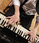 Close-Up of the Piano Player Performing