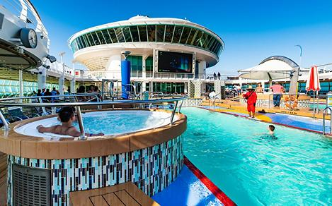 Guests Enjoying the Pool and Jacuzzi on Enchantment of the Seas