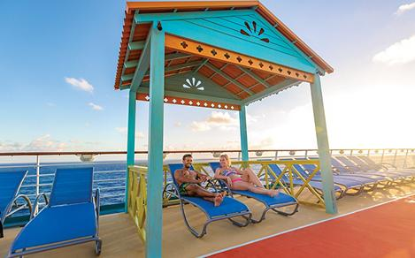 Navigator of the Seas Couple in a Pool Deck Cabana