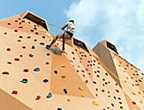 Man Climbing Down the Rock Wall