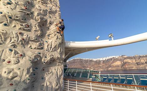 Rock Wall Climbing with Mountain Background