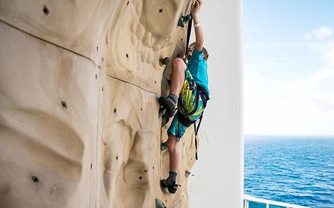 Young Boy on Rock Climbing Wall