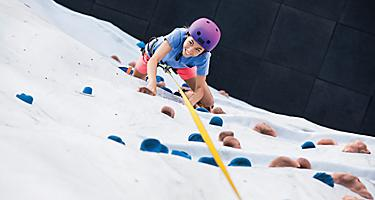 HM, Harmony of the Seas, Rock Wall, young woman, girl, teen, smiling, fun, effort, climbing, reaching, POV from above,