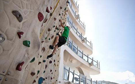 Man Climbing Rock Wall On Board Day Time