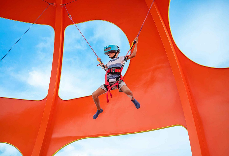 Skypad kid jumping with virtual goggles