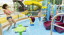 Kids Splashing Mom at Splashaway Bay Water Park