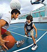 onboard or on board, ship or boat, father, son, basketball, court, hoop, basket, game, playing, dribble, shot, shoot, balls, sports, fun.  U S  Hispanic onboard or on board, voyager of the seas, voyager class, vy