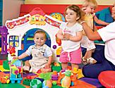 Three Toddlers Playing in the Babies and Tots Nursery