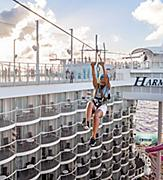 Woman Zip Lines through Harmony of the Seas