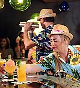Festive and tropical bartenders shaking up and serving delicious craft cocktails at Bamboo Room