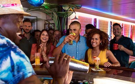 Guests Enjoying Cocktails at the Bar