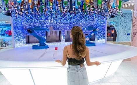 Bionic Bar Woman Picking a Cocktail