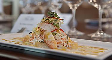 Lobster & Alaska king crab main entree, served at the Elegant Chefs Table restaurant. One of the best cruise line fine dining