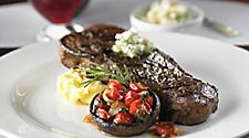 12 oz Grilled NY-Strip Steak served at the fine dining steakhouse, Chops Grille. One of the best cruise line restaurants.